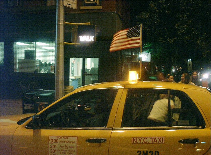 NYC taxi flying American flag